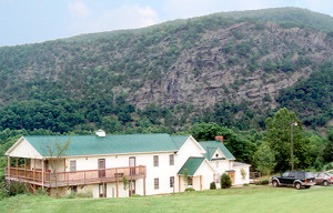 The Fly Fish Inn, overlooks Hole # 9 and the Jackson River